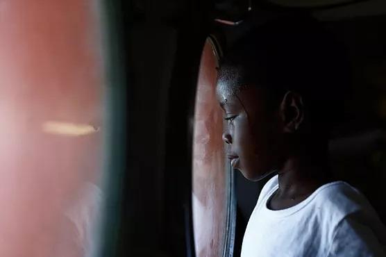Migrant Child Looks Through Porthole, Darrin Zammit Lupi. Used with permission.